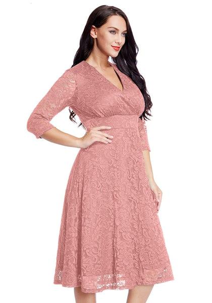 Angled shot of model wearing plus size old rose lace surplice midi dress