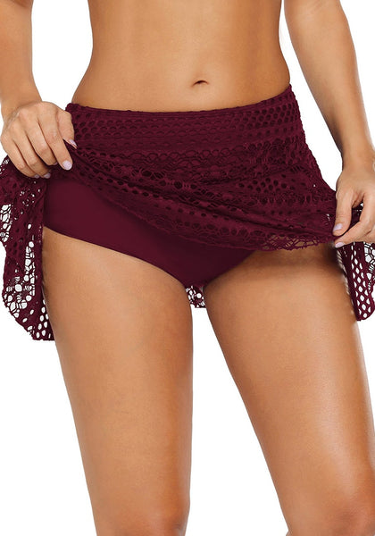 Angled shot of model wearing port lace crochet swim skirt showing details