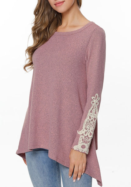Angled shot of model wearing rose pink crochet applique long sleeves asymmetrical top