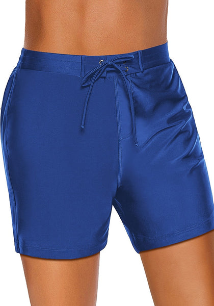 Angled shot of model wearing royal blue lace-up board shorts
