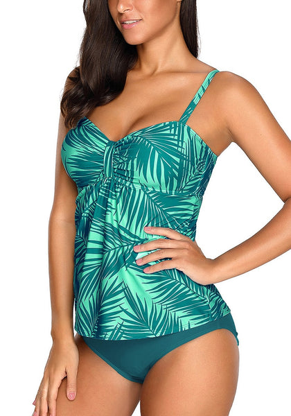 Angled shot of model wearing teal palm leaf-print ruched swimwear