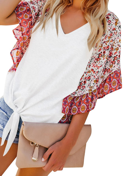 Angled shot of model wearing white boho-print flutter raglan sleeves tie-front top