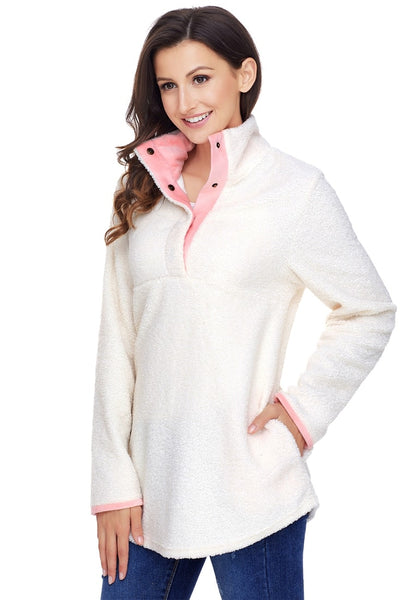 Angled shot of model wearing white button-front fleece pullover