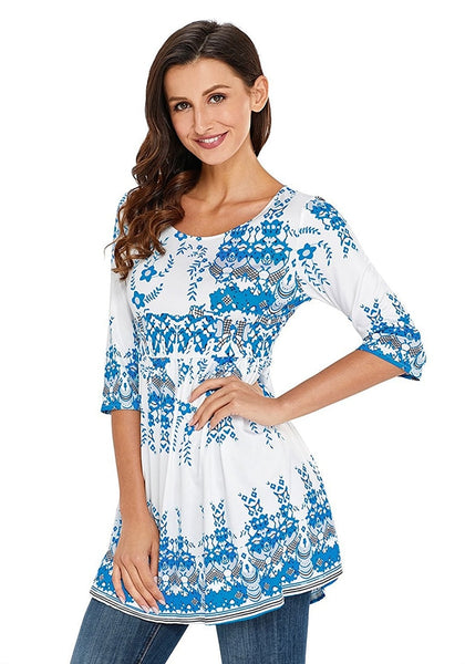 Angled shot of model wearing white floral-print flowy tunic
