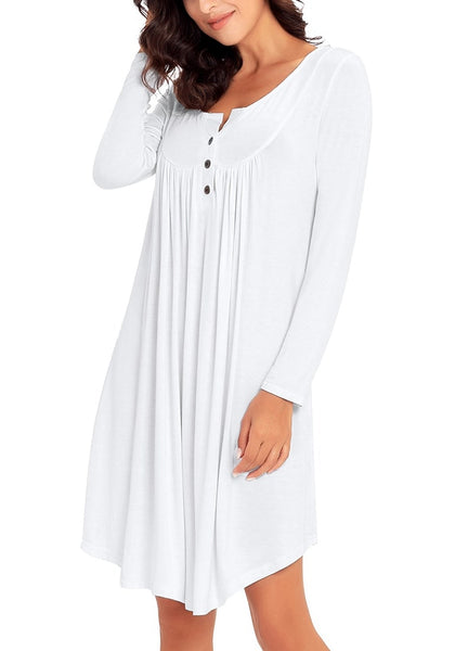 Angled shot of model wearing white long sleeves curved hem henley dress