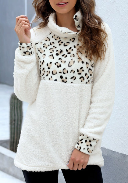 Angled shot of model wearing white oblique stand collar leopard fleece pullover