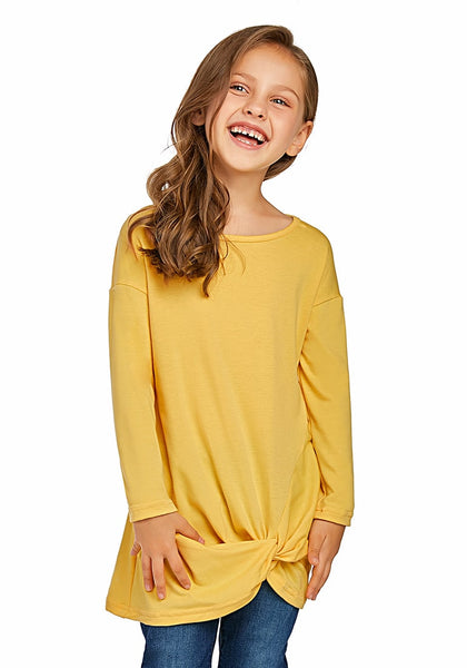 Angled shot of model wearing yellow long sleeves front twist knot girl top
