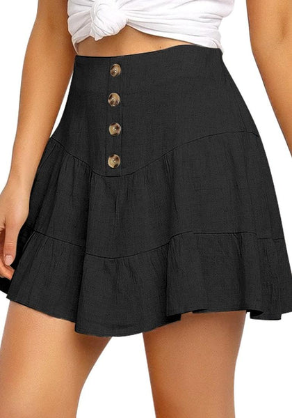 Angled shot of model working black button-front elastic-back ruffled mini skater skirt