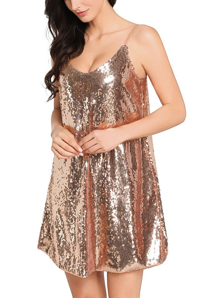 Angled shot of pretty model in champagne sequins slip dress