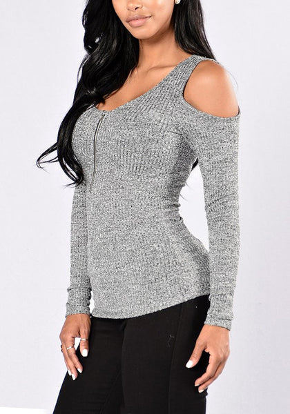 Angled shot of sexy model in grey cold shoulder zip-front top