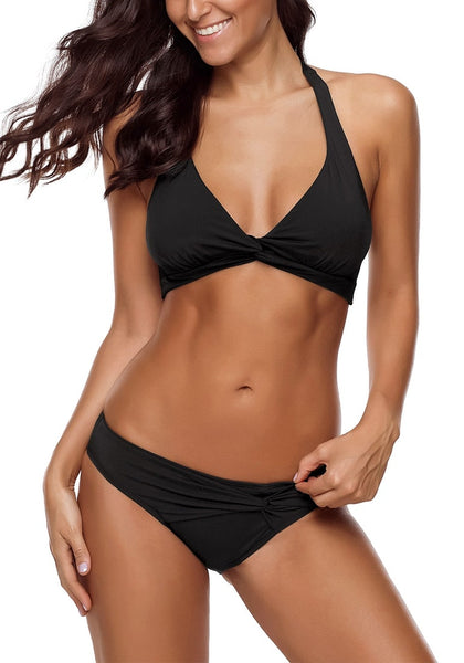Angled shot of sexy model wearing black ruched self-tie halter bikini set