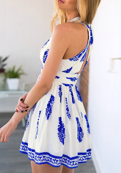 Angled shot of white-and-blue plunge embroidered skater dress in model