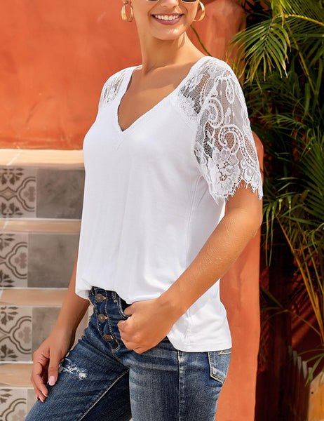 Angled shot of white crochet lace short sleeves V-neckline top