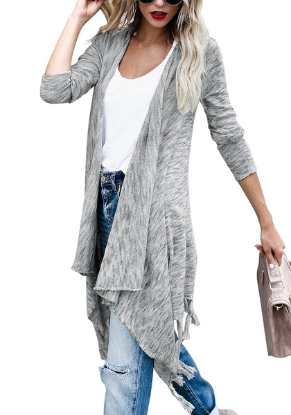 Angled shot of woman in grey long sleeves knitted open front tassel cardigan