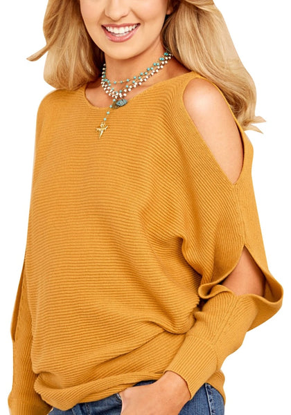 Angled shot of woman wearing mustard yellow cutout slit sweater