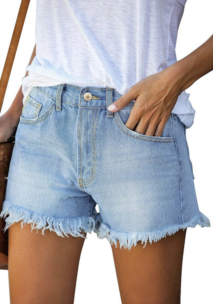 Angled shot view of model wearing light blue frayed hem washed denim jeans shorts
