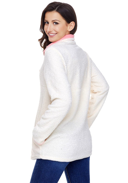 Angled side and back shot of model wearing white button-front fleece pullover