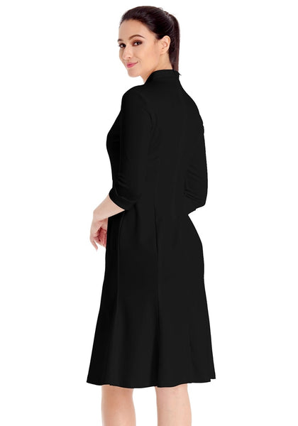 Angled side shot of model in black stand collar crop sleeves dress