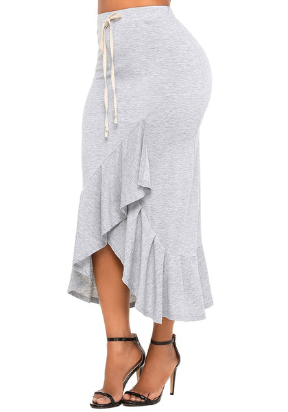 Angled side shot of model in grey ruffle asymmetrical hem long bodycon skirt