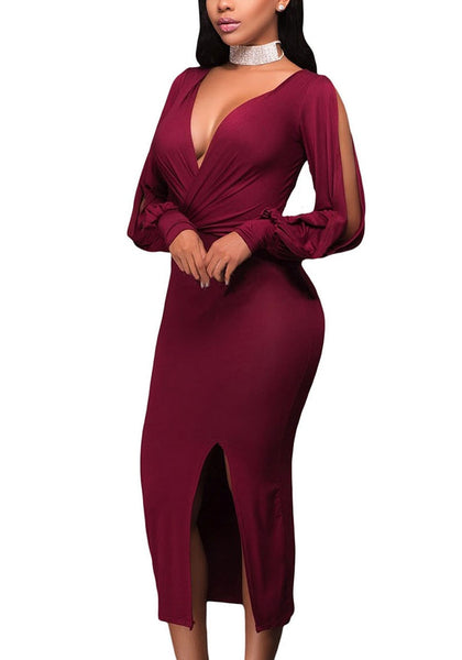 Angled side shot of woman in burgundy split sleeve ruched midi dress