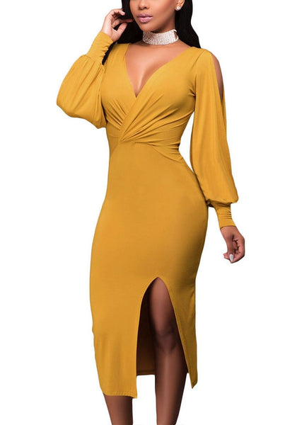 Angled side shot of woman in mustard split sleeve ruched midi dress