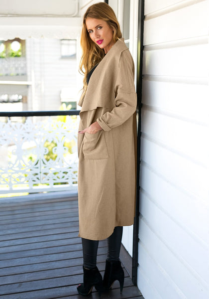 Angled side view of girl in camel draped open-front long coat