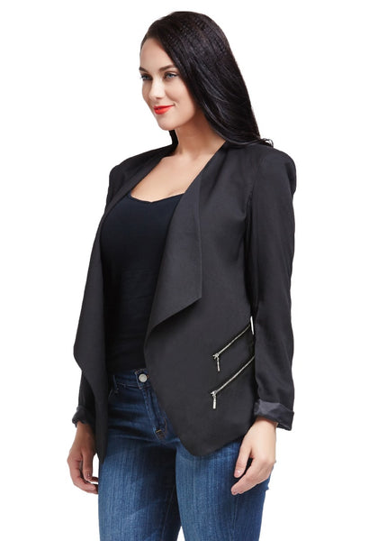Angled side view of model in black padded-shoulder draped blazer