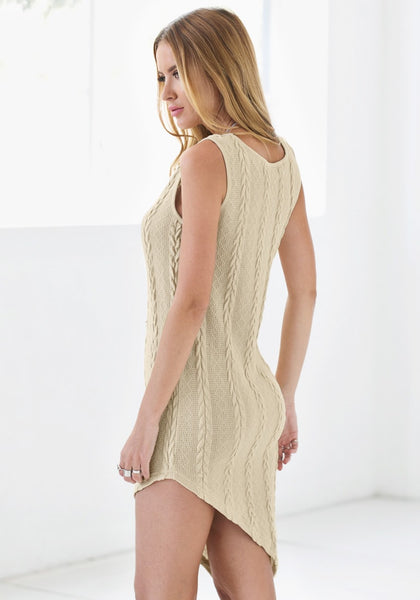 Angled view of braided cable knit asymmetrical dress