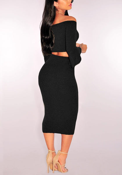 Angled view of model in black ribbed knit bell-sleeved two-piece skirt set