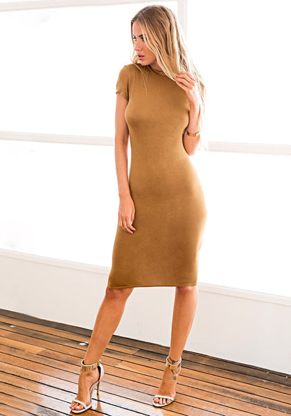 Angled view of model in brown midi sheath dress