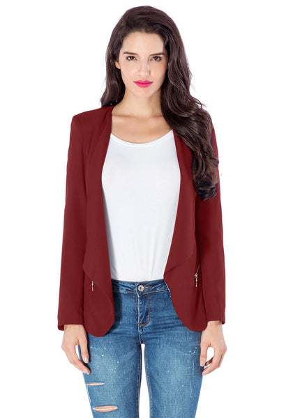 Angled view of model in burgundy draped blazer