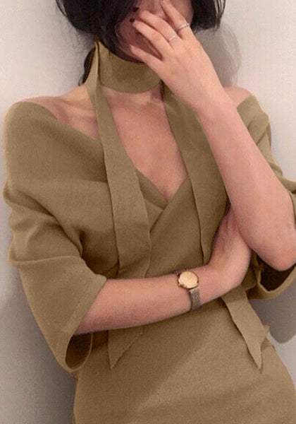 Angled view of model in khaki wrap pencil dress