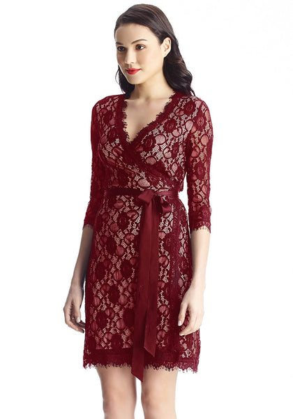 Angled view of model in maroon lace overlay plunge wrap-style dress