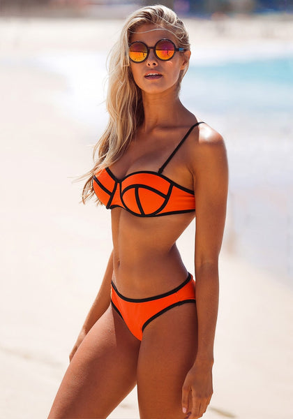 Angled view of model in neon orange bikini set