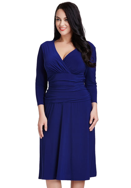 Angled view of model in plus size royal blue ruched waist dress