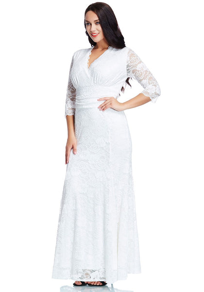 Angled view of model in plus size white lace long dress