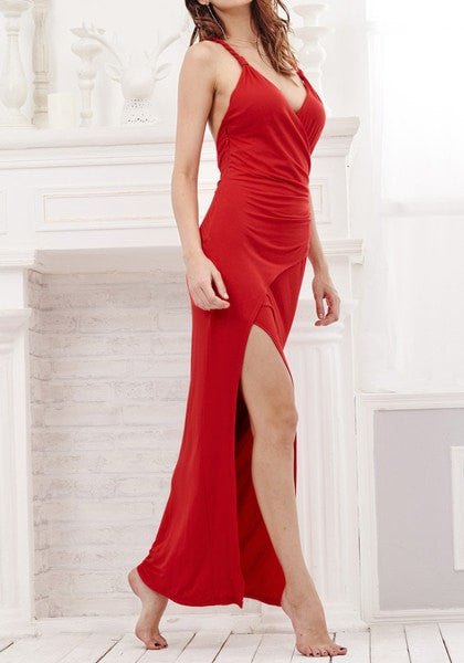 Angled view of model in red side slit dress