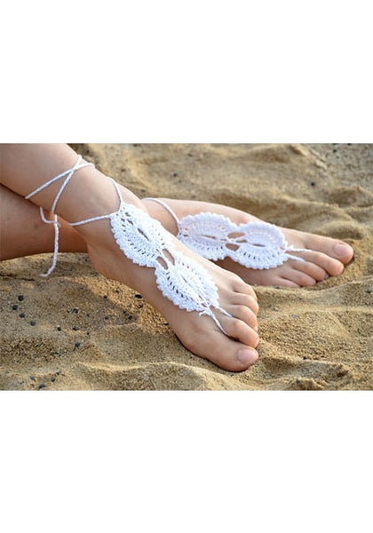Angled view of model in white barefoot sandal