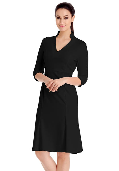 Angled view of model wearing black stand collar crop sleeves dress