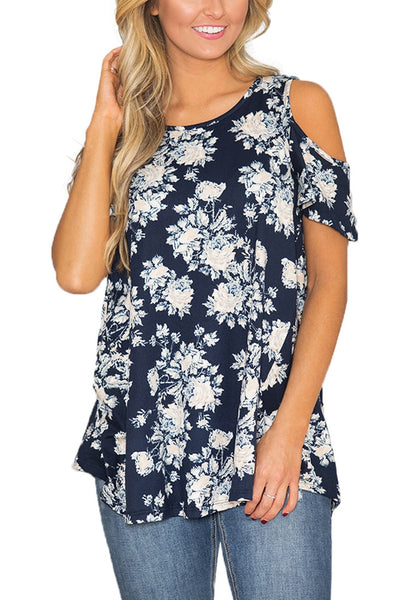 Angled view of model wearing navy floral cold-shoulder blouse