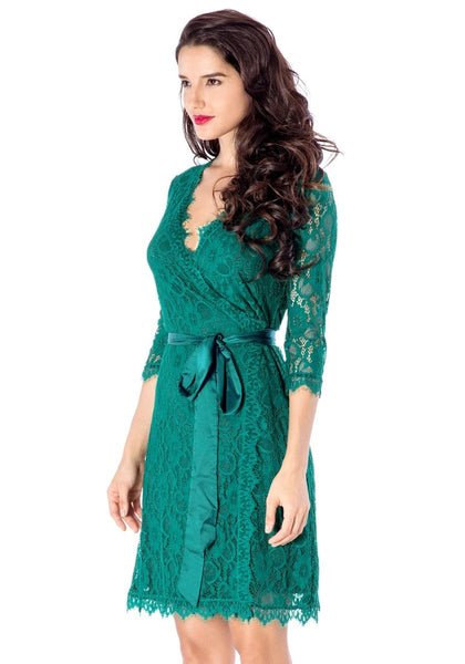 Angled view of model wearing teal lace overlay plunge wrap-style dress