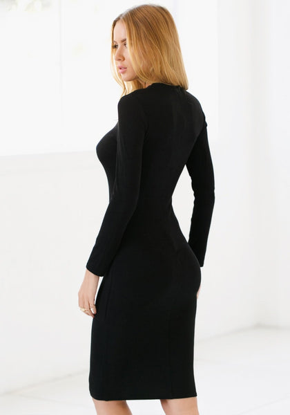 Angled view of model with black mock neck midi dress