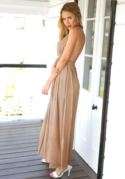 Angled view of woman in cameo color strappy plunge dress