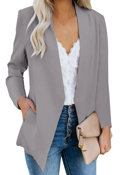 Angled shot of model in grey open-front side pockets blazer