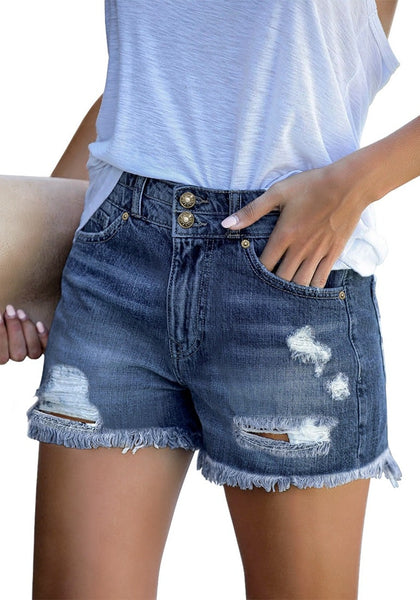 Angled shot of model wearing dark blue double raw hem ripped jean shorts