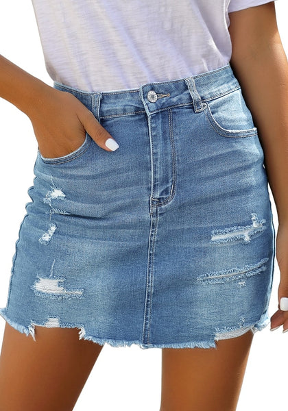 Angled shot of model wearing light blue distressed frayed hem denim mini skirt