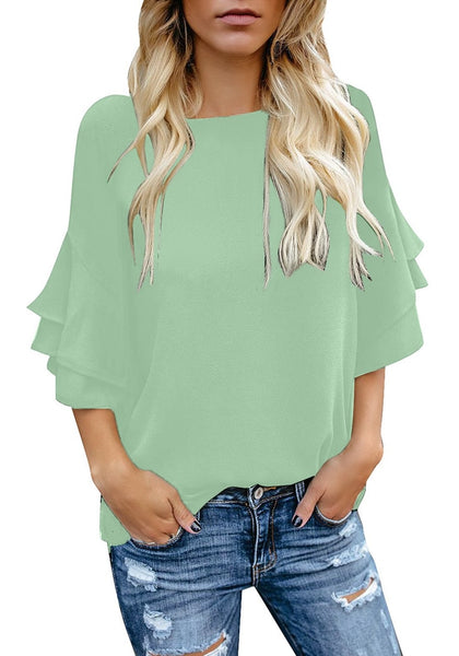 Model wearing mint green trumpet sleeves keyhole-back blouse