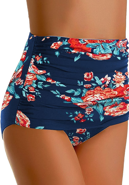 Angled shot of model wearing navy floral-print high waist ruched swim bottom