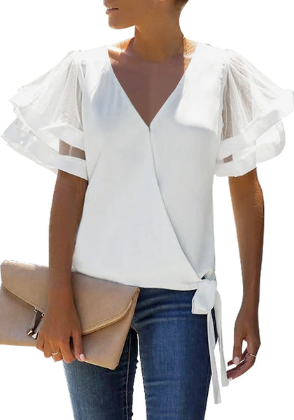 Angled shot of model wearing white V-back mesh butterfly sleeves side-tie wrap top