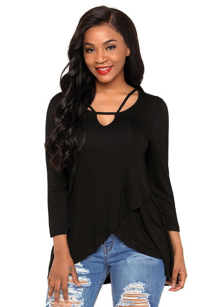 Front view of model wearing black strappy 34 sleeves tulip-hem blouse